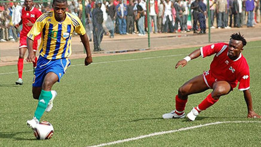 Elias Uzamukunda (R), seen here playing for Amavubi against Burundi in 2011, has been summoned back to the national team after a four year absence.  Courtesy