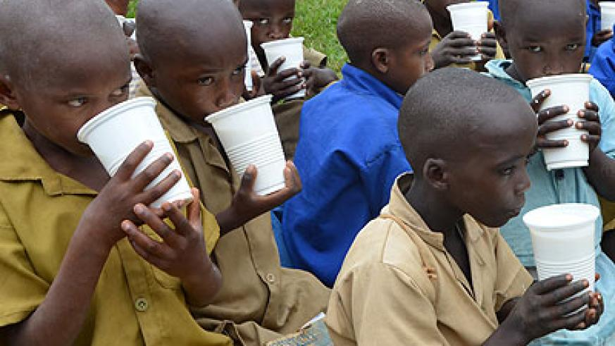 School children take milk in Bugesera District. Making milk available to children is one of the factors that have helped fight child mortality. File
