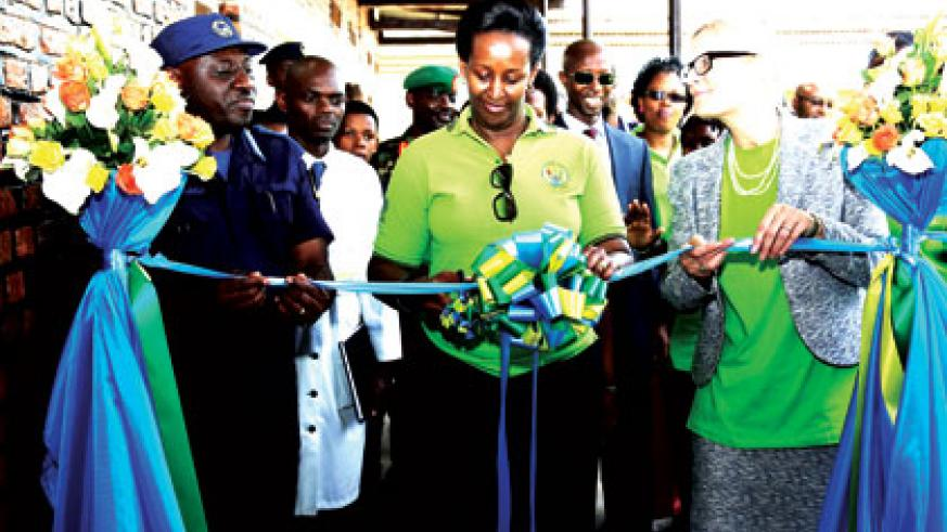 The First Lady, Jeannette Kagame, cuts the ribbon to launch the Isange One Stop Centre at Nyagatare Hospital yesterday, with the help of IGP Emmanuel Gasana and the Dutch Ambassado....