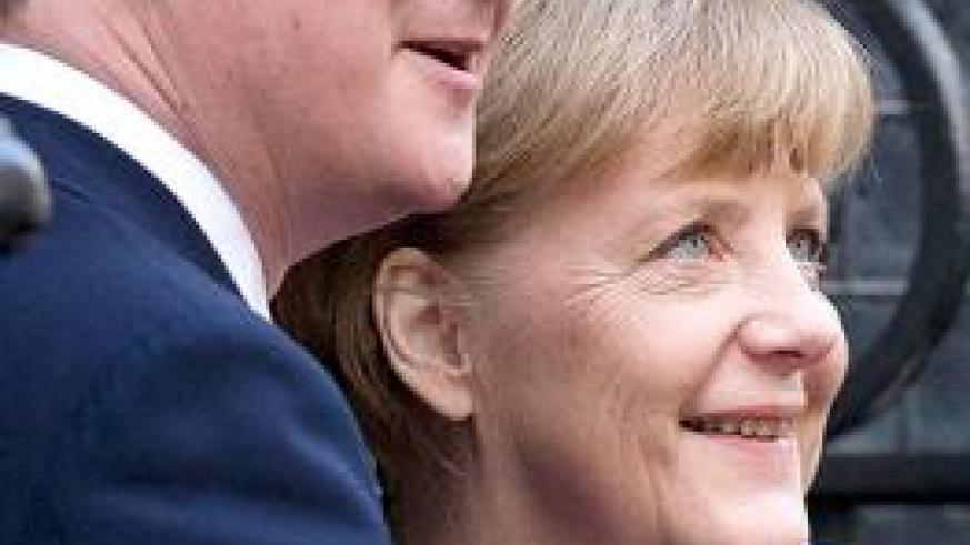 Britain's Prime Minister David Cameron (left), poses with Germany's Chancellor Angela Merkel on the doorstep of 10 Downing Street in London. Net photo.