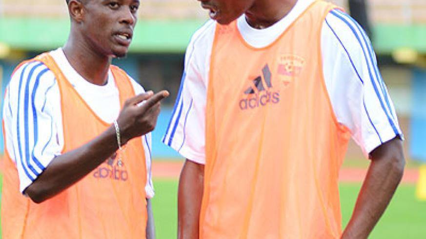 In the absence of Haruna Niyonzima (left), Jean Baptiste Mugiraneza (right) will be the likely candidate to captain Amavubi in Bujumbura. File