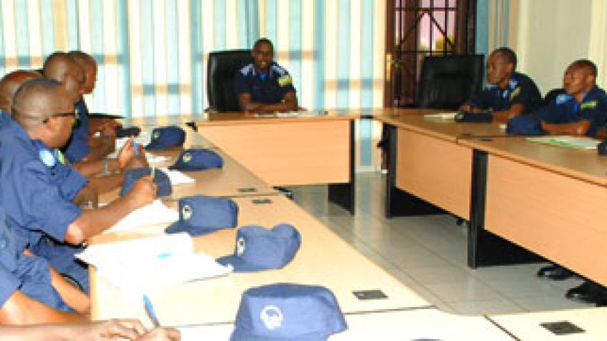 Munyuza (C) briefs Police officers during the peacekeeping pre-deployment exercise in Kigali yesterday. Courtesy.