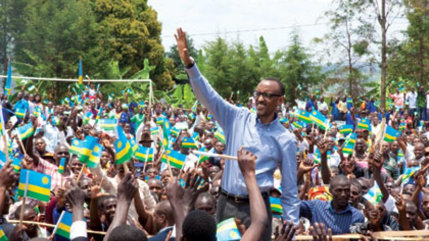 President Kagame waves to the residents of Rulindo District on his arrival  at Rutongo grounds yesterday.  Timothy Kisambira.