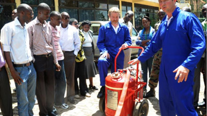 Experts train members of security agencies on handling of fire-fighter equipment in Kigali in 2012. File.