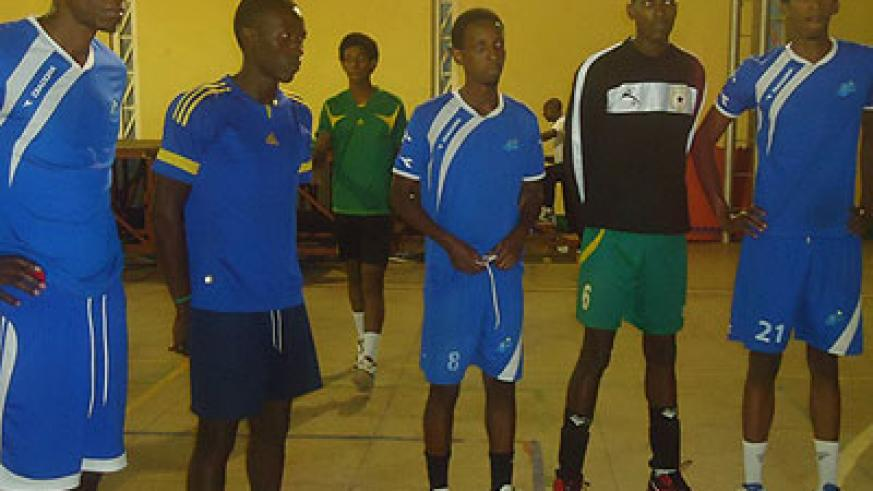 Some of Rayon Sports' players listening to their coach Fidele Nyirimana (below),   during a training session. File