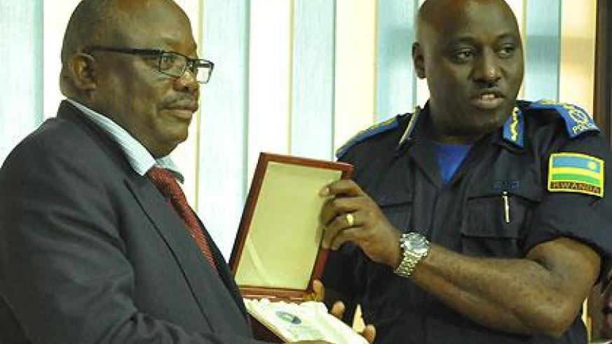 IGP Emmanuel K. Gasana exchanging gifts with his Namibian counterpart, Lt. Gen. S.H. Ndeitunga. Courtesy
