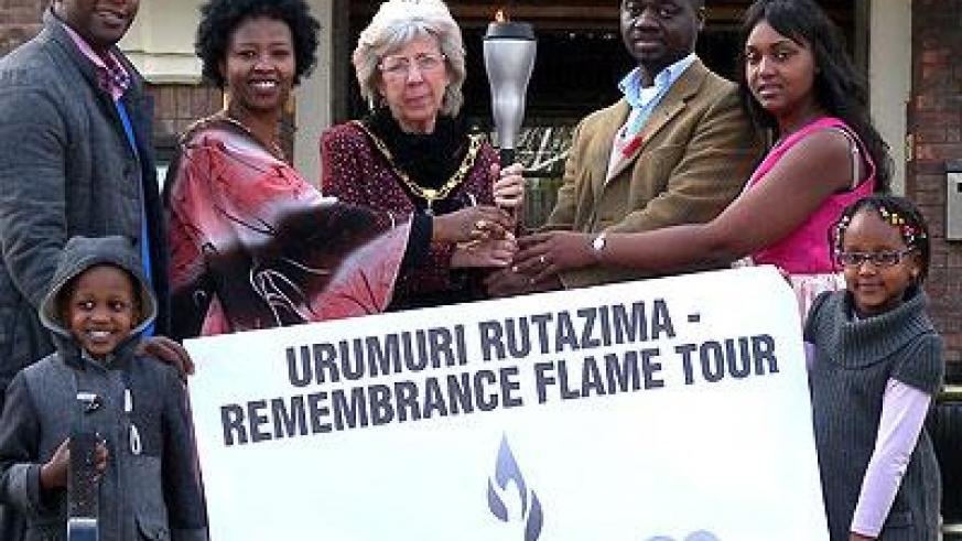 The Mayor of the Borough of Broxtowe, Iris White (C) receives the flame. Courtesy