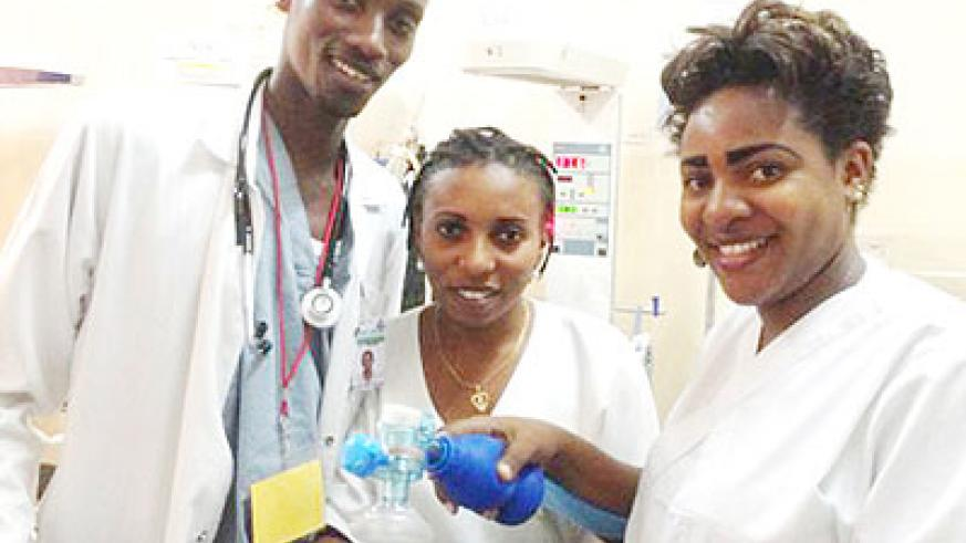 Dr Athanase (L) poses with nurses at Kibagabaga Hospital after training in neonatal resuscitation. Courtesy photo.