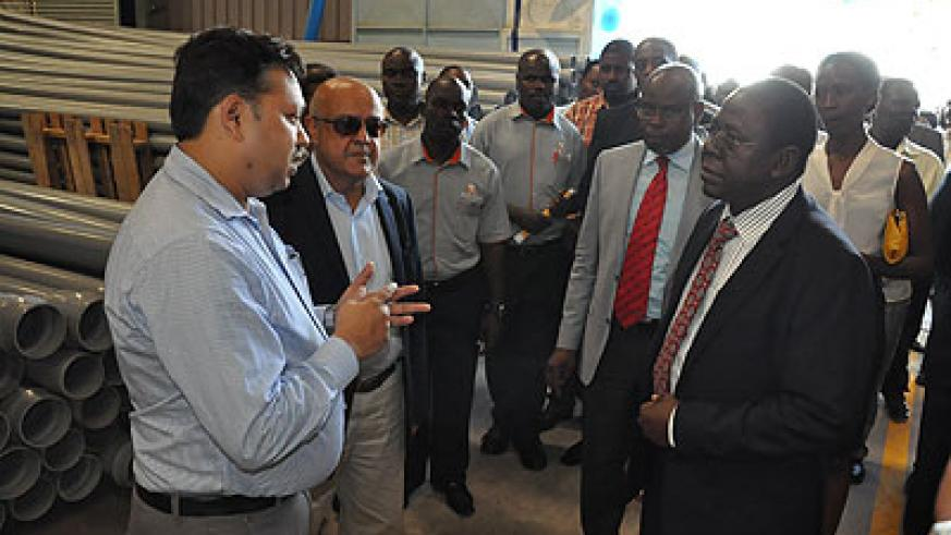 Eng. Kabirizi, (in a black suit, right) the director of water development in Uganda's Ministry of Water launched the plant on Friday.  Courtesy.