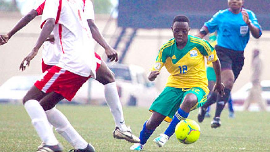 Sophie Niyomugaba seen dribbling past Kenyan defenders in the first leg scored the lone goal for Rwanda in the 2-1 loss to Kenya yesterday. Rwanda marched into the second round on ....