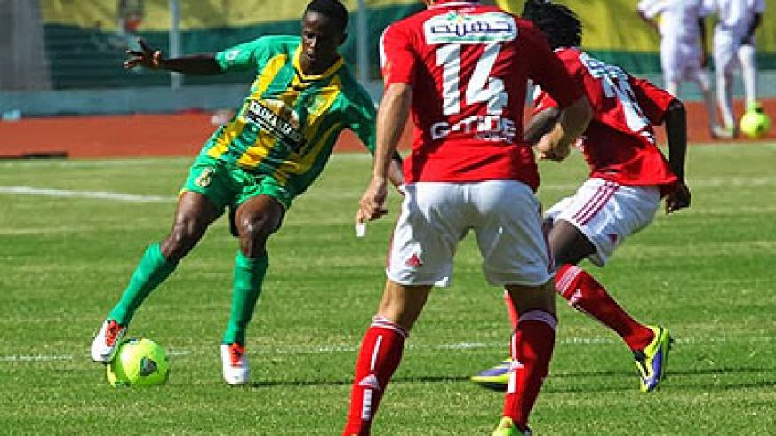 Haruna Niyonzima rounds off Al Ahly players in Saturday's Africa Champions league clash. Young Africans won the tie 1-0 in Dar es Salaam.