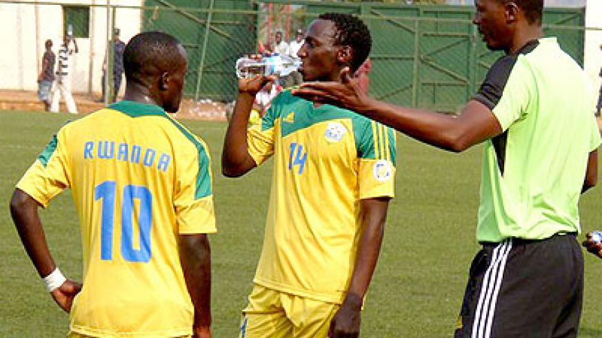 Eric Nshimiyimana, (right), talking to his players during a training session at Stade de Kigali.