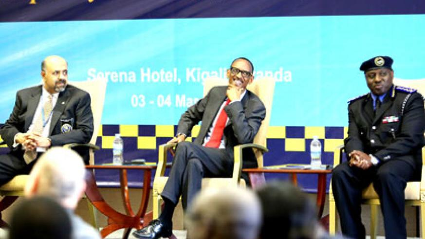 President Kagame (C), IGP Gasana (R) and the president of International Association of Chiefs of Police, Yost Zakary, at the sub-Saharan Africa Executive Policing Conference in Kig....