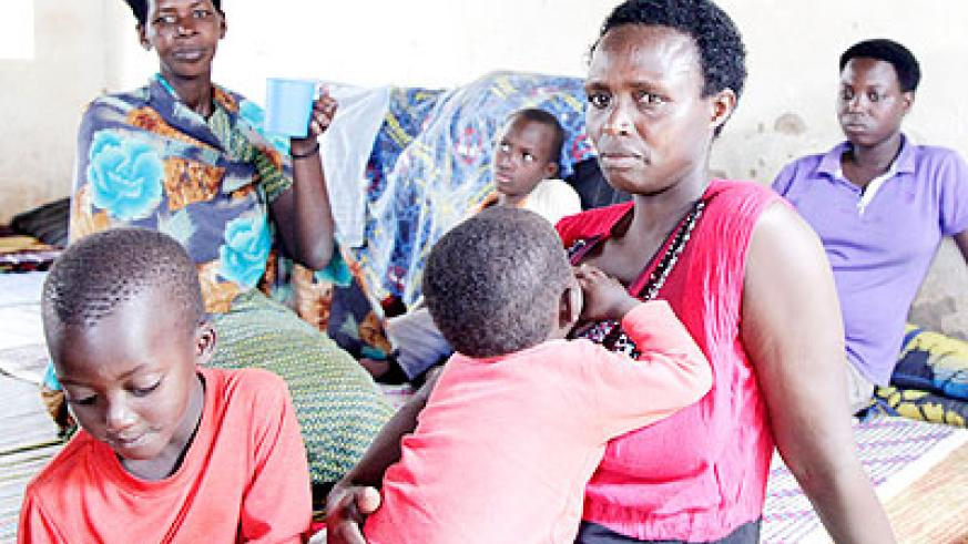 Returnees from Tanzania in temporary shelter await resettlement in Jabana Sector, Gasabo District. File.