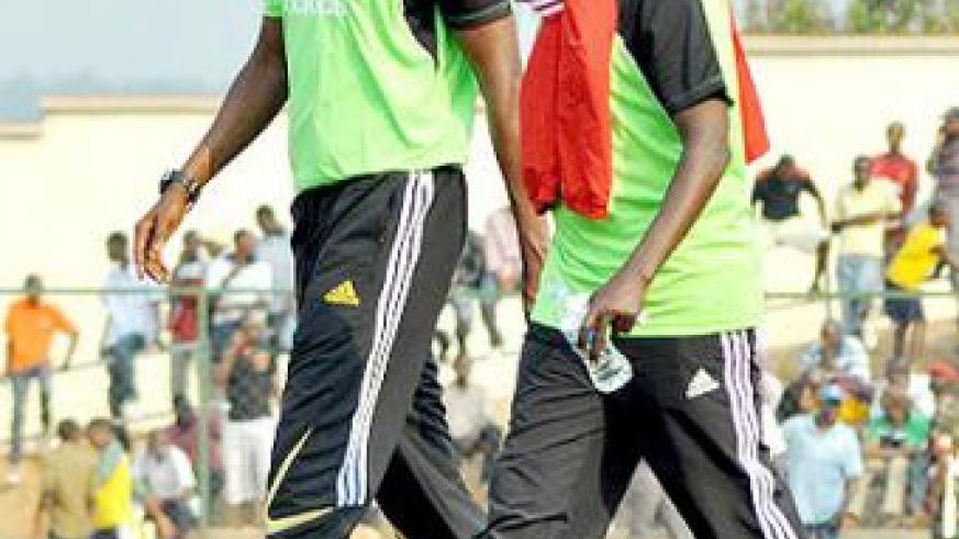 WALKING A TIGHT ROPE; The contract of Eric Nshimiyimana, (left), and his assistant Jean Baptiste Kayiranga will expire this month. File