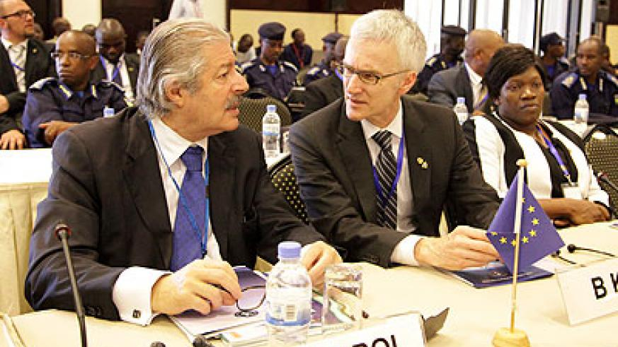 Europol Deputy Director Operations Michel Quill (L) chats with another delegate at the conference on Monday. John Mbanda.