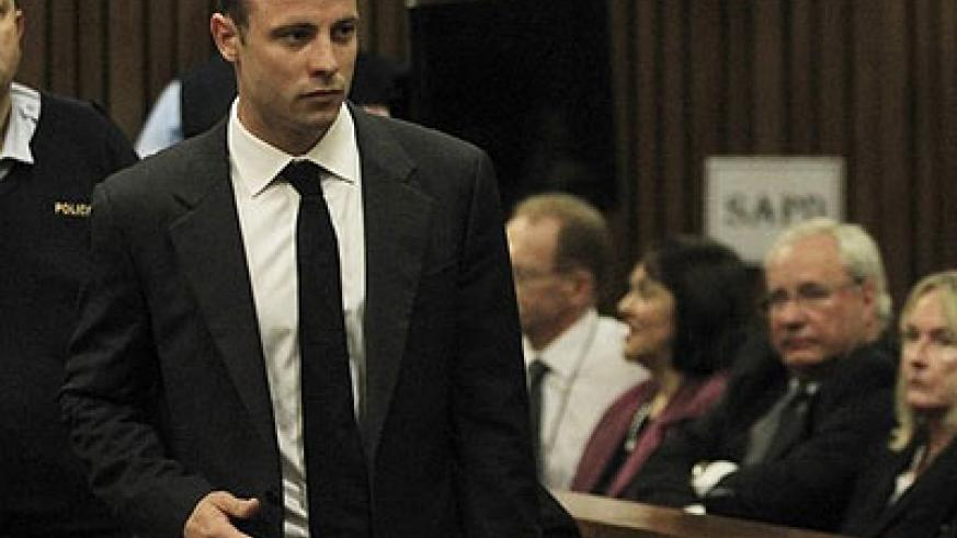 Oscar Pistorius walked into the court without any apparent glance at the relatives' bench. Net photo.