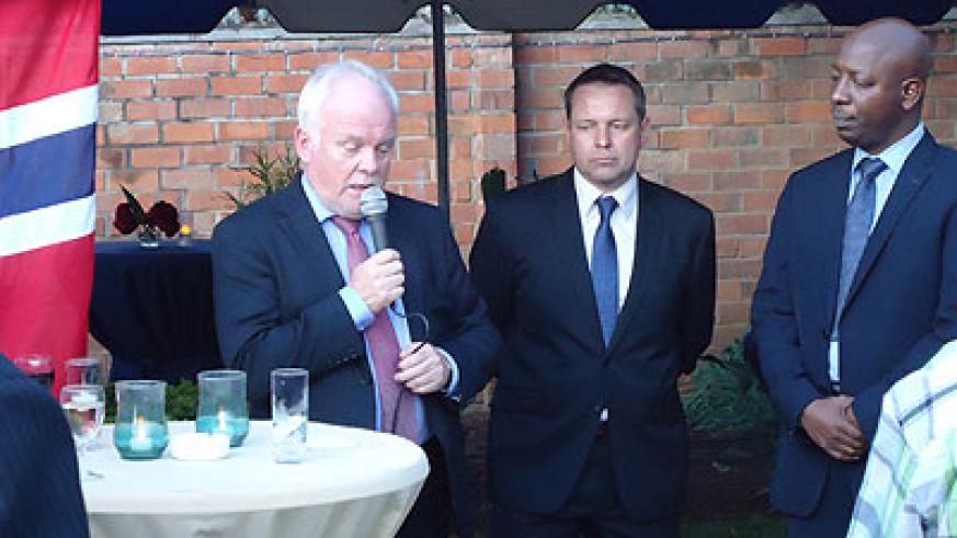 Gaustadsaether (L), Norway's ambassador to Rwanda, with Robert Woffenden (centre), the new consular during the re-opening of the consulate. (Peterson Tumwebaze)