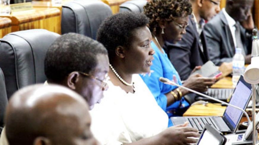 MP Marie Josée Kankera raises a point during the session at which Minister Gatete presented the revised National Budget for approval before Parliament yesterday. .John Mbanda.