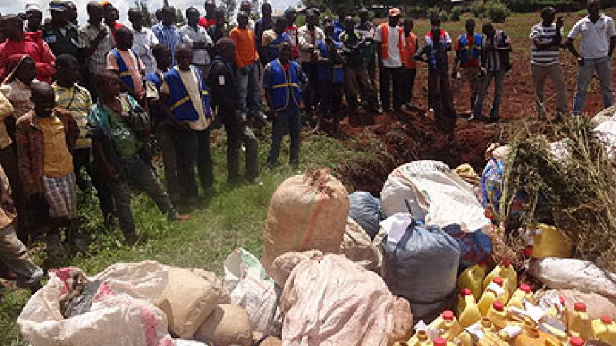 Residents witness destruction of the drugs in Kirehe District yesterday. Stephen Rwembeho.