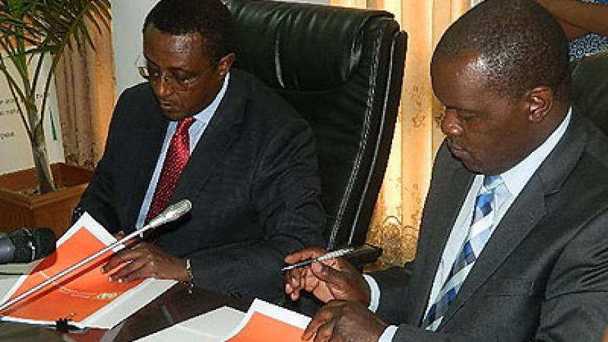 Education minister, Vincent Biruta and Microsoft country manager for Eastern and Southern Africa, Eric Odipo, during the signing of the deal on Thursday. John Mbanda.