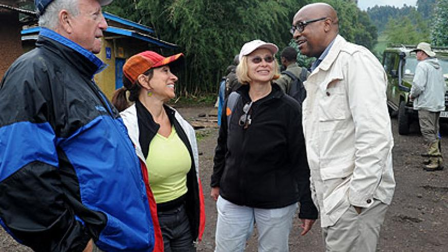 Joseph Birori (R), the Managing Director of Primate Safaris, chats with tourists just outside Virunga National Park last year. Tour operators are optimistic that the recognition of....