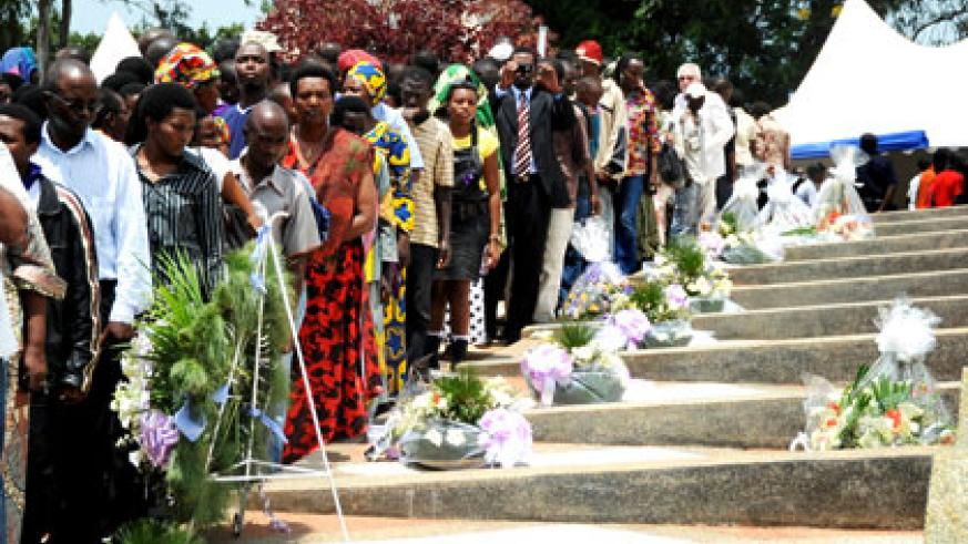 People pay tribute to Genocide victims at Rebero during a past event. Simbikwanga is accused of being a mastermind of the killing. File.