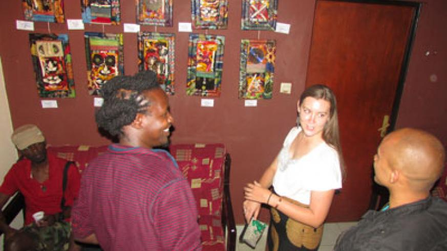 Attendees admire some of the pieces exhibited by Hakizimana in honour of women on Saturday.