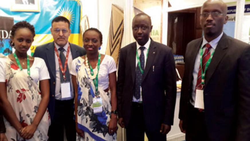 Joseph Kabakeza, First Consular at the Rwandan High Commission in India (second, right) with Clarence Fernandes, RDB India representative (second from the left) at the Rwandan boot....