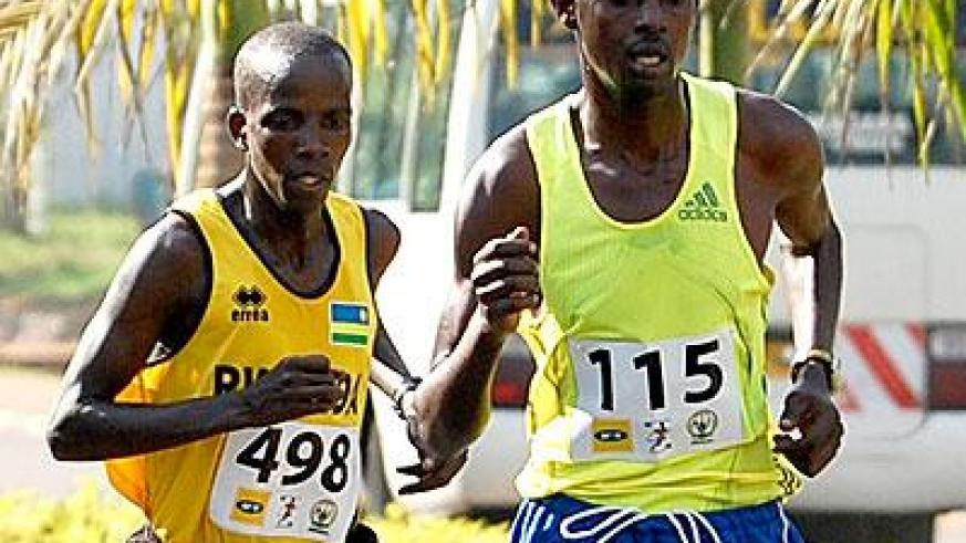 Godfrey Rutayisire, right, seen here competing in a past half marathon race, will lead Rwanda's quest for medals in  Kampala. (File)