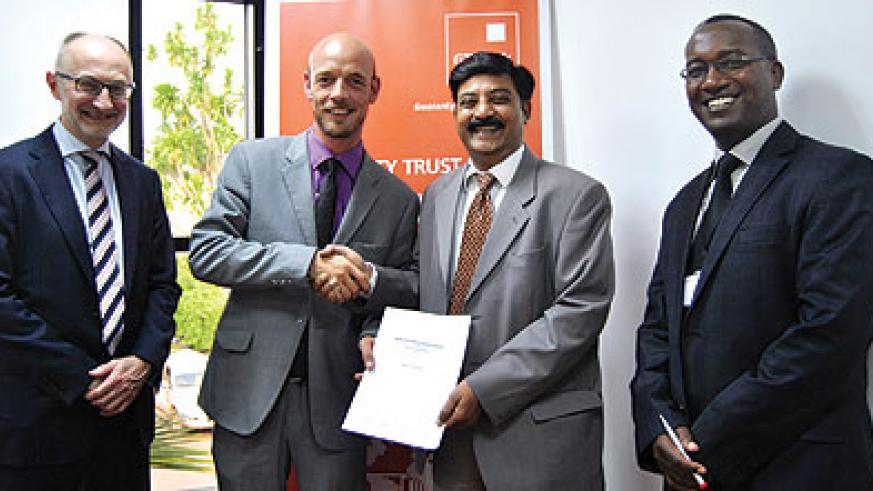 Andreas (second, left) and Anantapur (second, right) and other bank officials after the signing of partnership deal on Friday. The New Times /  Courtesy photo