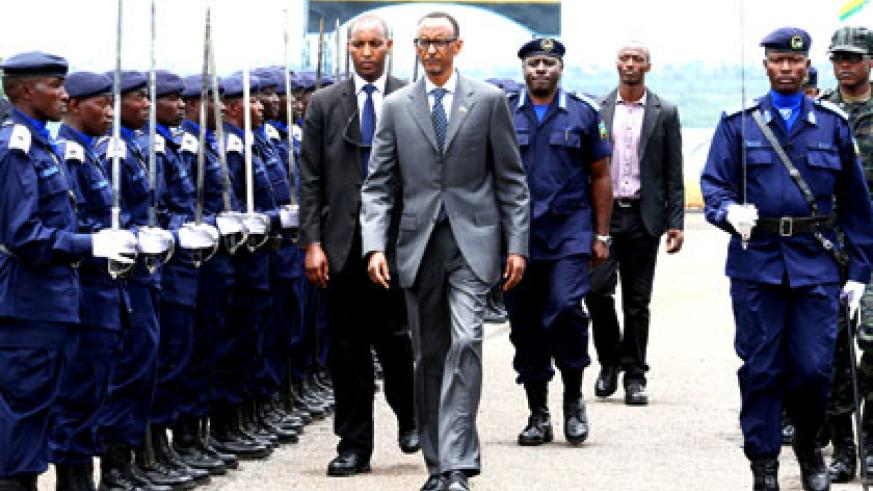 President Kagame inspects a guard of honour mounted by Rwanda National Police at the passing out of cadet-officers at Police Training Academy in Gishari, Rwamagana District, yester....