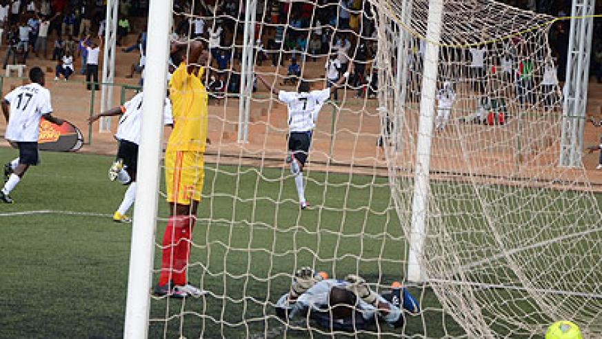 Jean Baptiste Mugiraneza, #7, lead APR celebrations after heading home the winner, which left Etincelles  keeper with face down. Samuel Ngendahimana