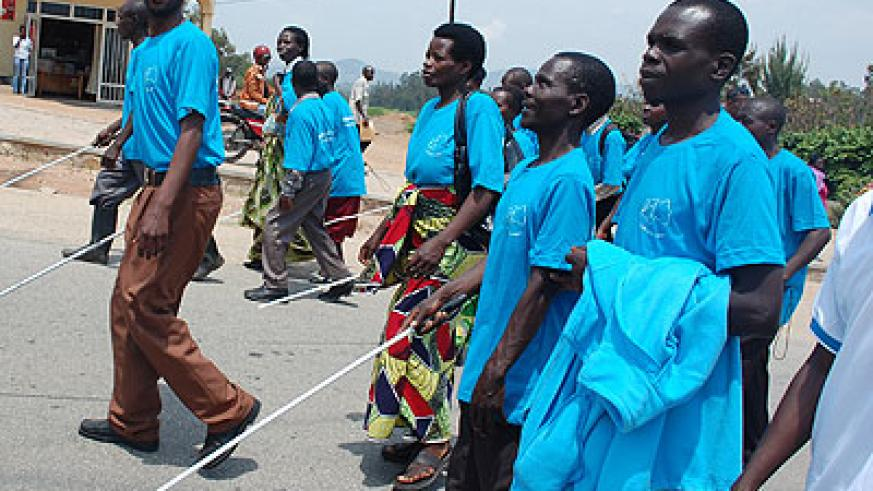Visually impaired people during the White Cane Awareness Campaign last year. (File)