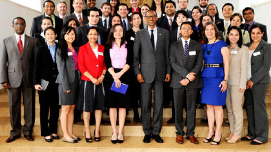 President Paul Kagame in a group photo with American MBA students at Village Urugwiro yesterday. Village Urugwiro.