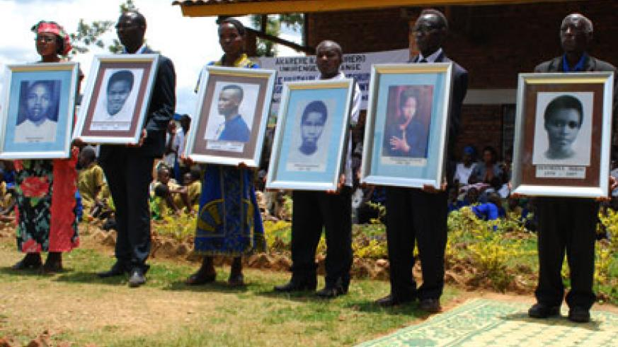 Parents and Nyange Massacre survivors hold the  portraits  of  the students killed by the Interahamwe militia after they refused to divide themselves along ethnic lines. Hyppolite ....