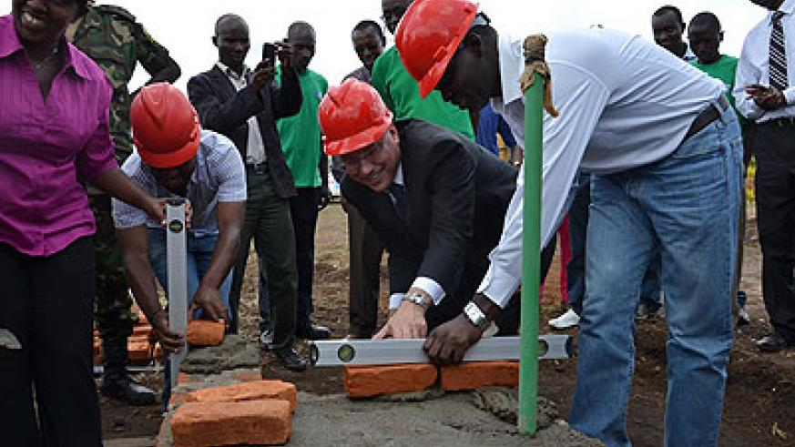 Usaid Rwanda Mission Director Peter Malnak (2nd right), and the Minister for Natural Resources, Stanislas Kamanzi (right) at the ground-breaking ceremony for the construction of th....