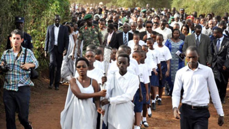 Hundreds of residents joined the journey as the Flame was carried from Mwurire Cell headquarters to a local memorial site on Thursday. JP Bucyensenge.