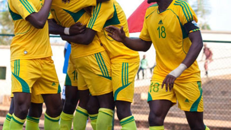 AS Kigali players celebrate Rodrigue Murengezi's goal against Al  Ahly Shendi at Stade de Kigali in the last round. File.