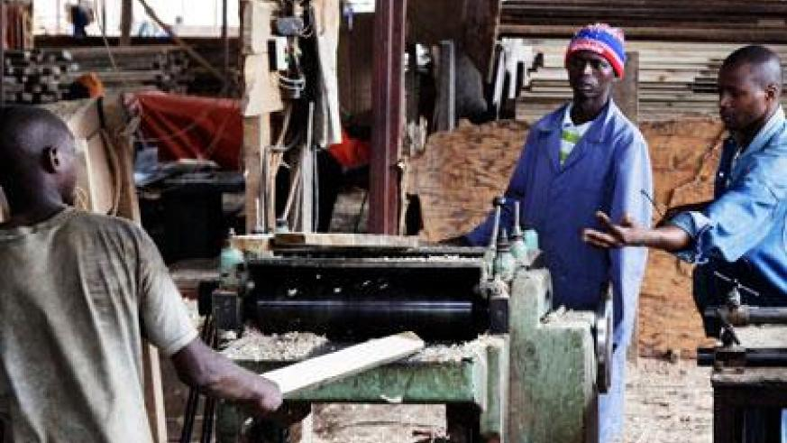 Workers at a workshop in Gakinjiro. Much as the law protects them from exploitation, it is silent on the minimum wage. (Timothy Kisambira)