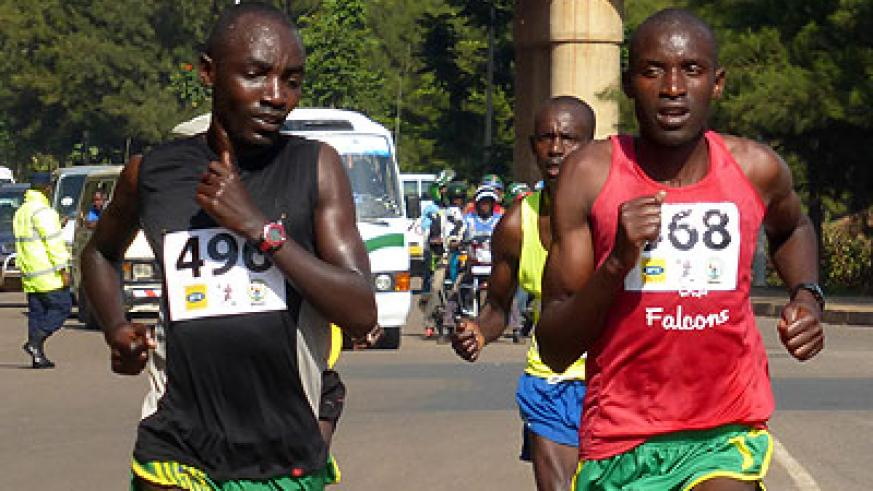 Alexis Nizeyimana (L) and Félicien Muhitira compete in last year's MTN Kigali Half Marathon. They will lead Rwanda's search for a silverware in Copenhagen on Sunday. (Timothy Kisambira)
