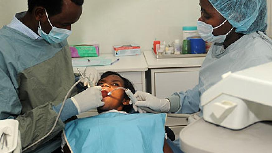 Dentists attend to a patient at Kigali Health Institute in 2012. (John Mbanda)