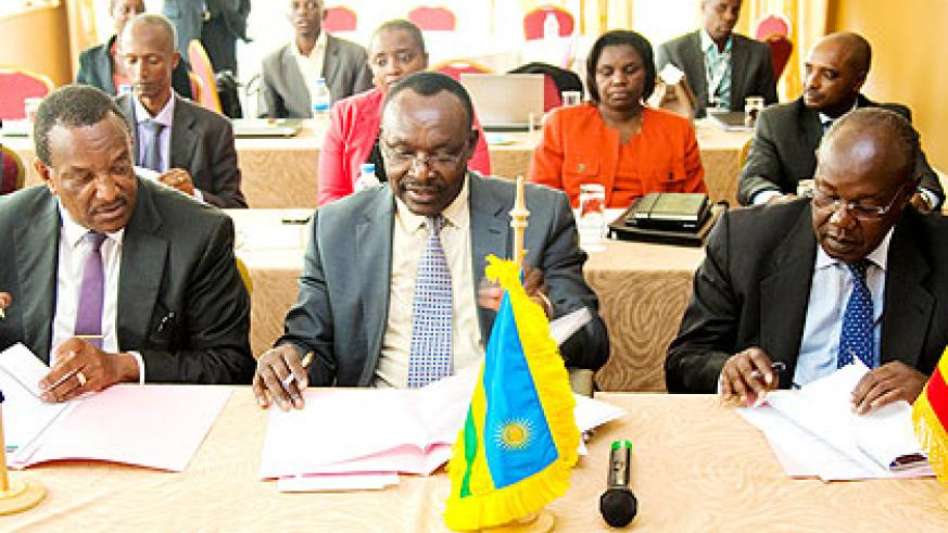 <p>Trade and Industry minister François Kanimba (C), Uganda's state minister of Internal Affairs James Baba (R), and Joseph WN Nyagah, the national coordinator Norther....