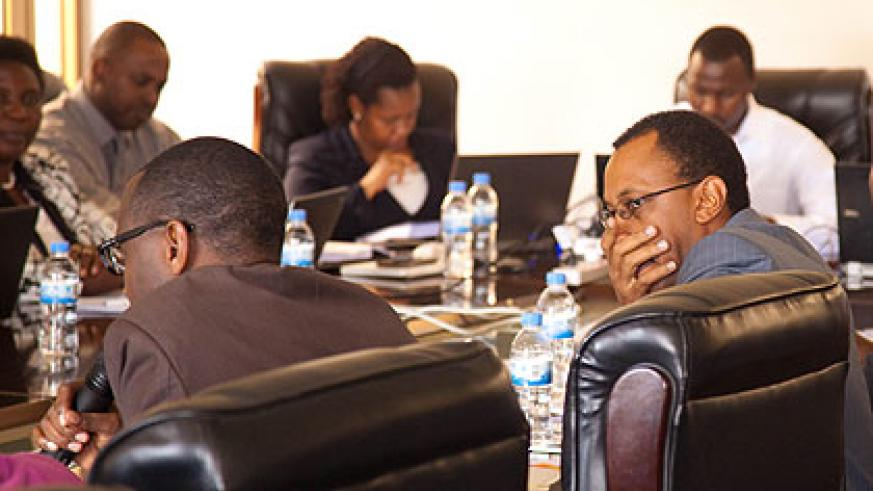 EWSA's board chairperson, Papius Musafiri (left), and Director General of EWSA, Ntare Karitanyi (2nd left) appear before MPs on Tuesday. (File)