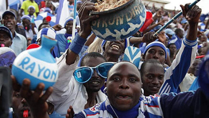 Rayon Sports supporters celebrate their team's win over their biggest rivals, which took them to the top of the table. (John Mbanda)