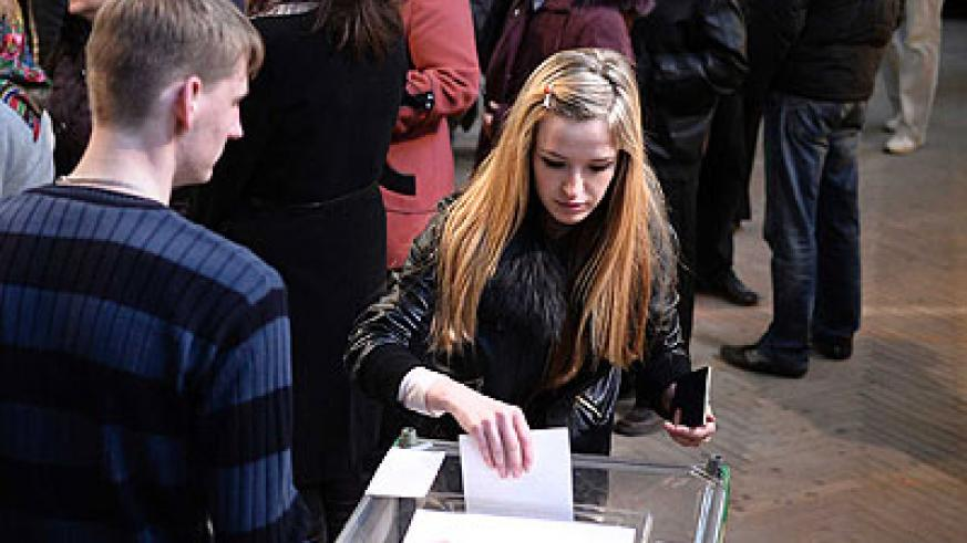 "Local residents vote on the Crimean referendum in Simferopol. Voters had two choices: Joining the Russian Federation or ""restoration of 1992 Crimean Constitution and Crimea's s...."