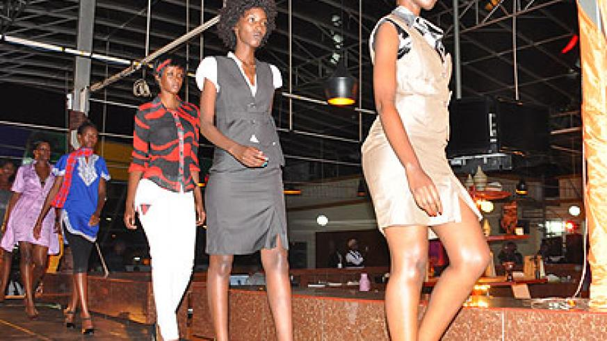 Models display designs on the runway during the Kigali Fashion Week 2012. (File)