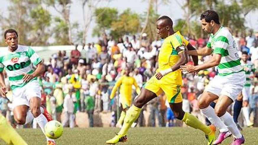 AS Kigali striker Jimmy Mbaraga controls the ball past Jadida defender Ahmed Chagou during the first leg. Chagou converted a spot kick to score the third goal for the Moroccans yes....