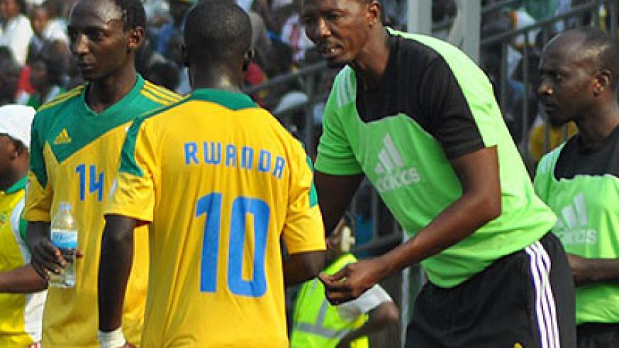 Nshimiyimana (R) gives instructions to a player in a previous game. (File)