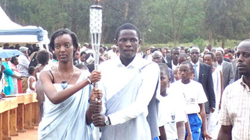 The Flame arrives at Camp Kigali in Nyarugenge from Kirehe District yesterday. (Jean-Pierre Bucyensenge)